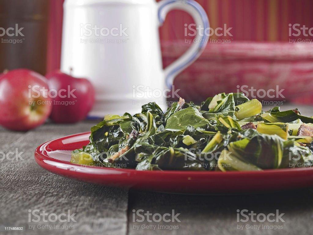 Fresh collard greens and smoked bacon stock photo