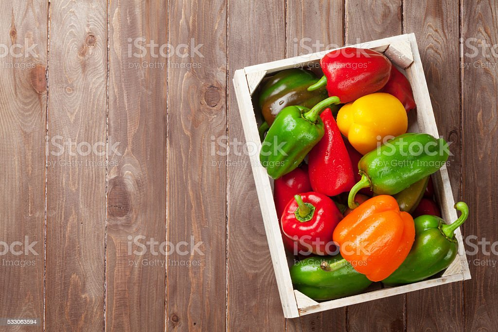 Fresh colorful bell peppers in box stock photo