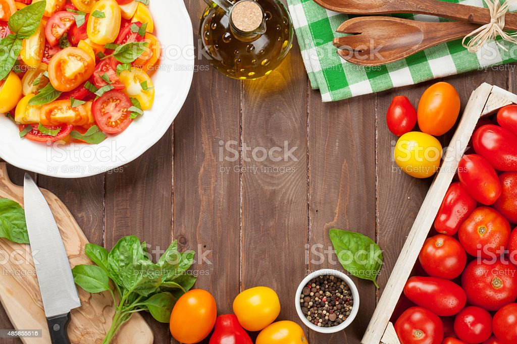 Fresh colorful tomatoes and basil salad stock photo