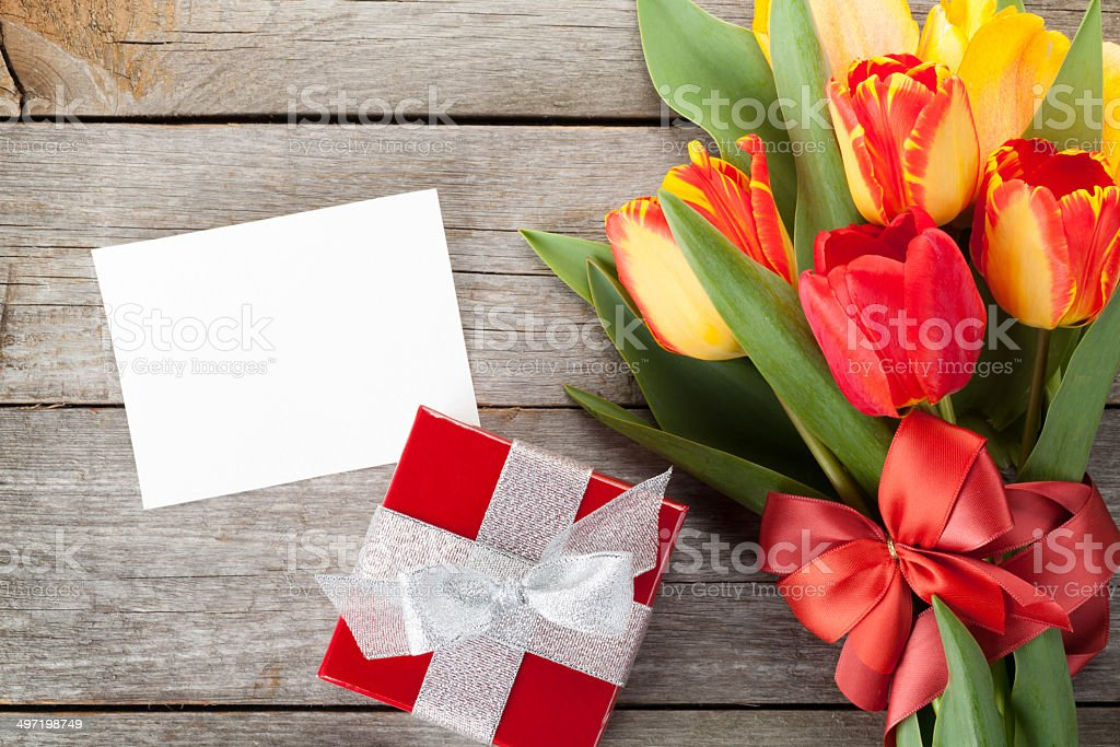 Fresh colorful tulips with gift box and greeting card stock photo