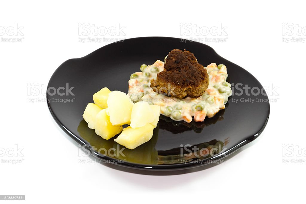 Fresh Cooked Rissole with Creamed Vegetables and Salt Potatoes stock photo