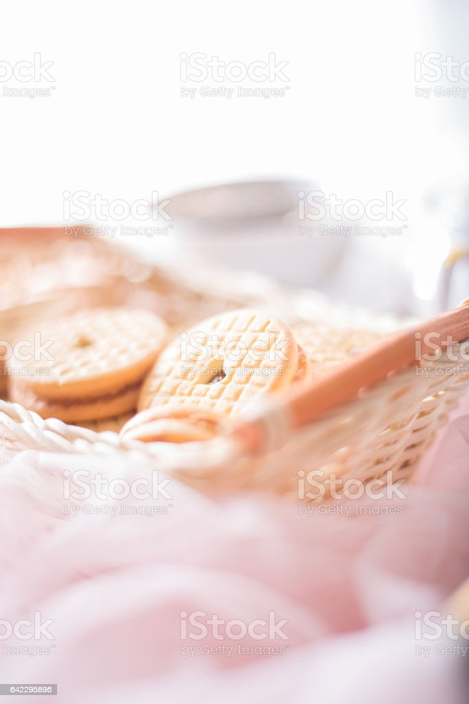 Fresh cookies in a small basket. stock photo