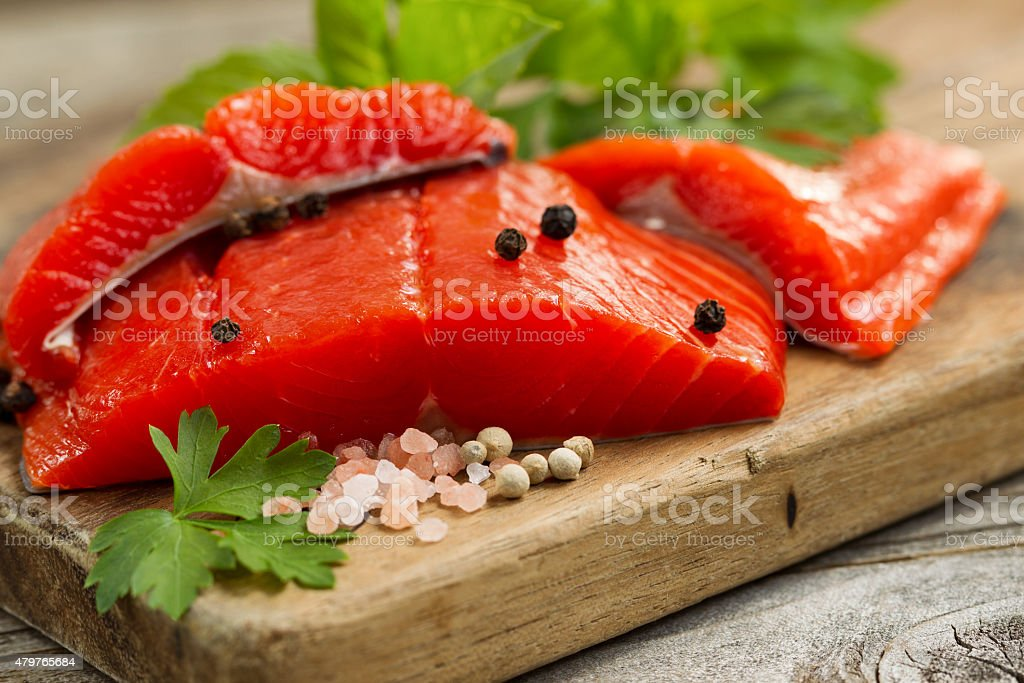 Fresh Copper River Salmon fillets on rustic woode stock photo