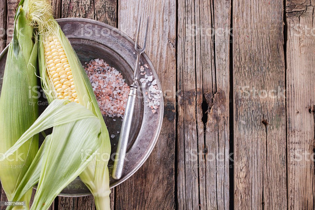 Fresh corn on the cob on vintage platters stock photo