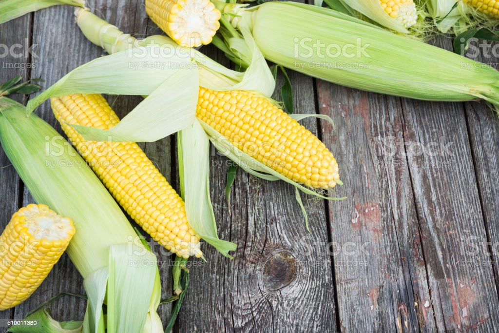 Fresh Corn on wooden table stock photo
