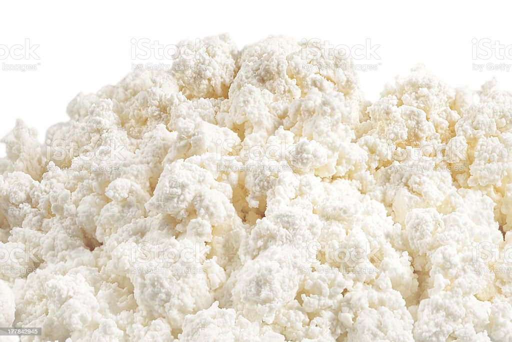 Fresh cottage cheese (curd) heap, isolated on white background . stock photo