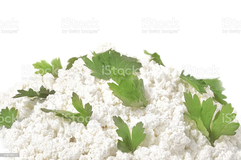 Fresh cottage cheese (curd) heap with parsley, isolated on white stock photo
