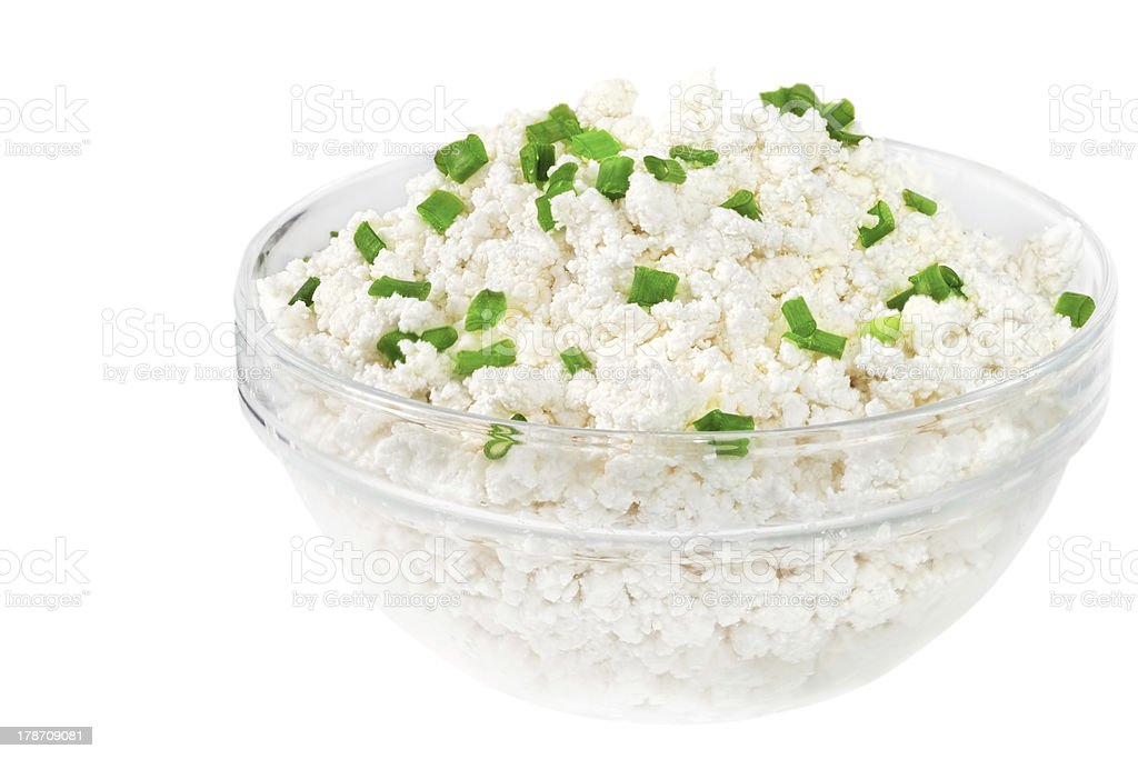 Fresh cottage cheese (curd) in glass bowl, isolated stock photo