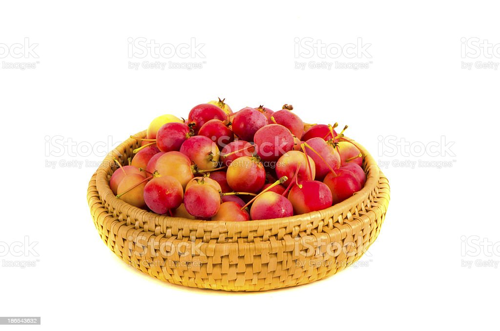 fresh crab apples in wooden plate isolated on white stock photo