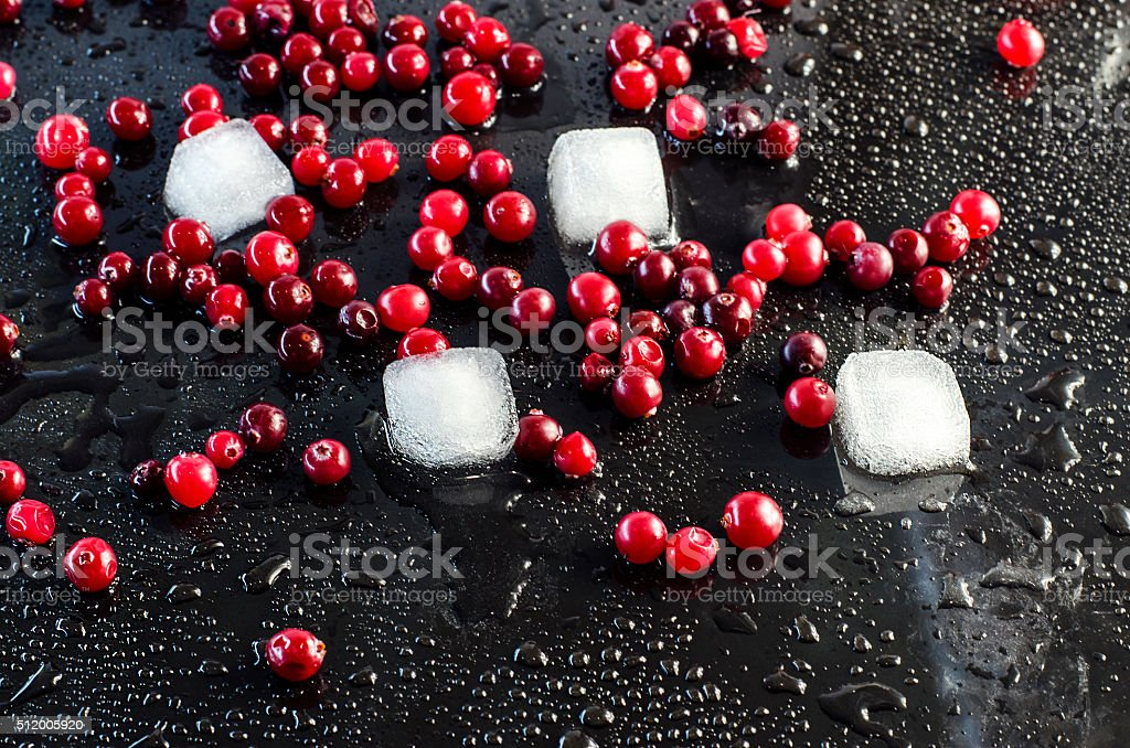 fresh cranberries in the water droplets stock photo