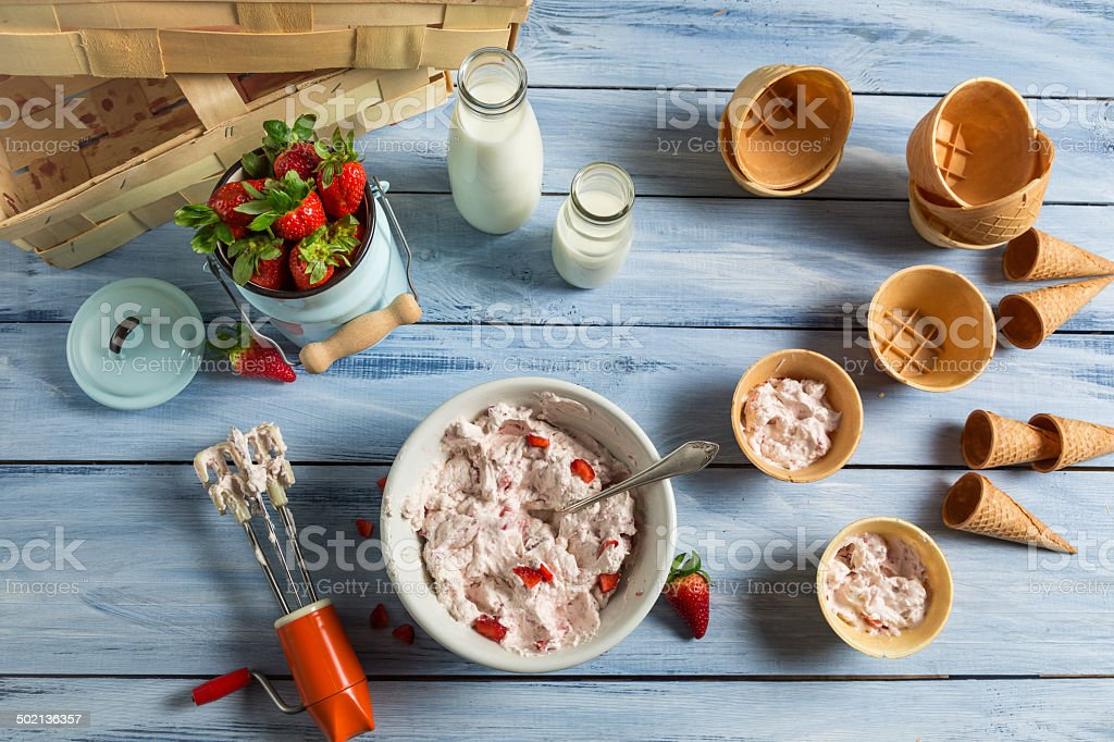 Fresh cream and strawberries as ingredients for ice cream stock photo