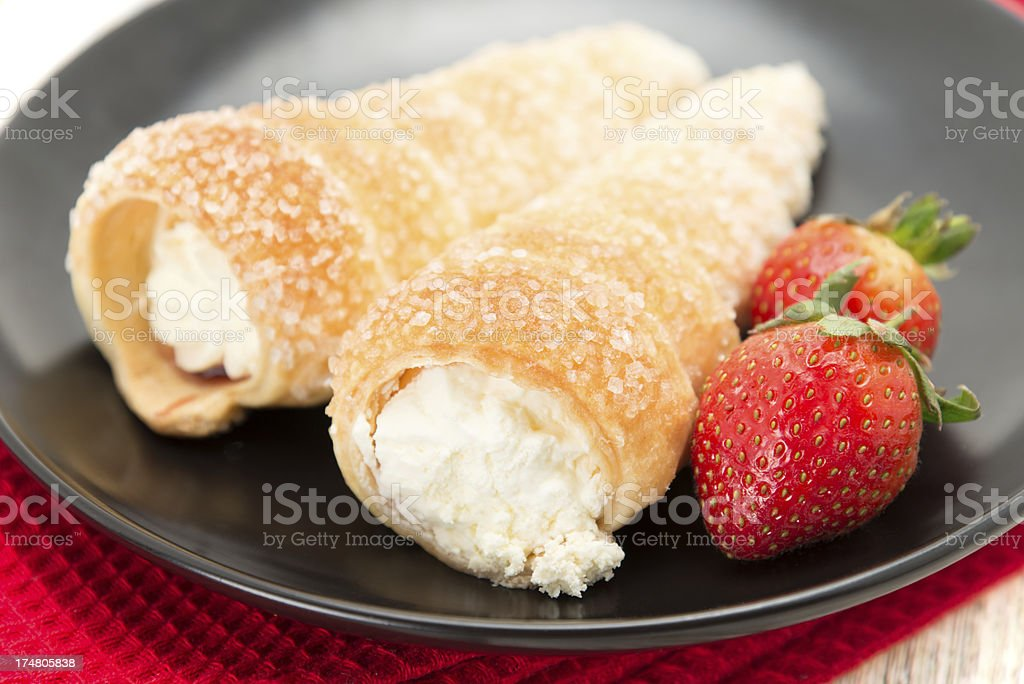 Fresh cream horn with strawberries stock photo