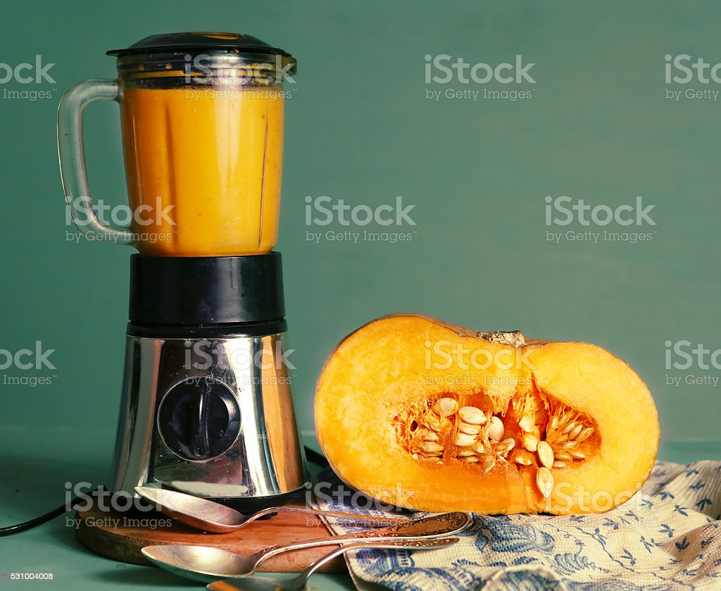 fresh  cream soup in mixer and cut pumpkin stock photo