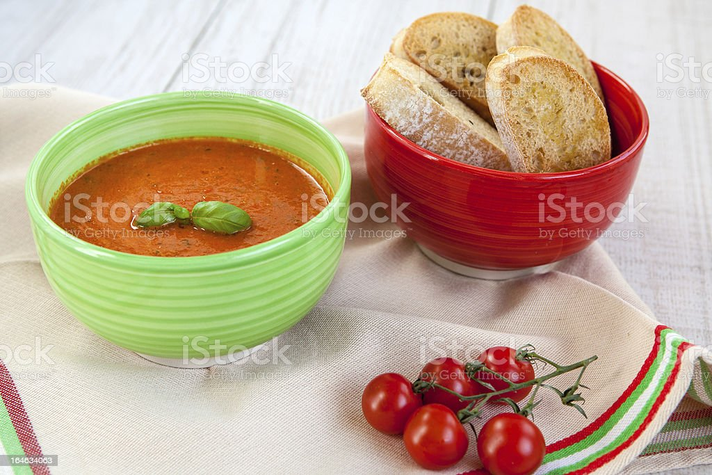 Fresh cream tomato soup with organic garlic and tomatoes royalty-free stock photo