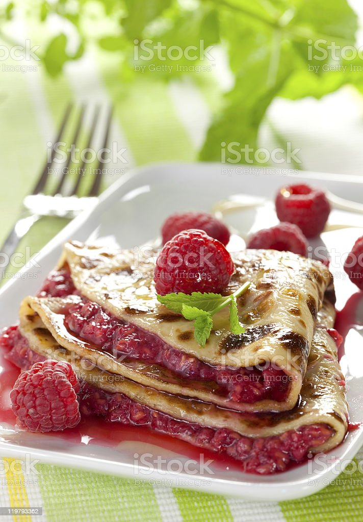 fresh crepe with raspberries royalty-free stock photo