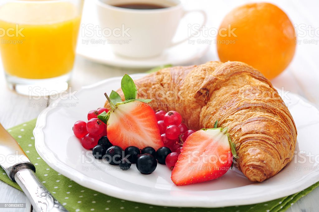 Fresh croissant with berries stock photo