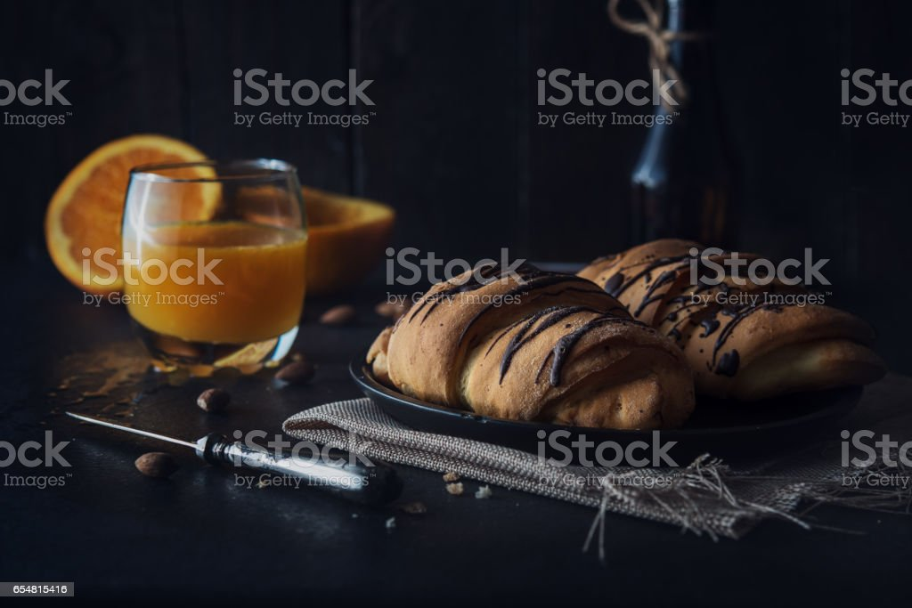Fresh croissant with chocolate glaze on breakfast stock photo