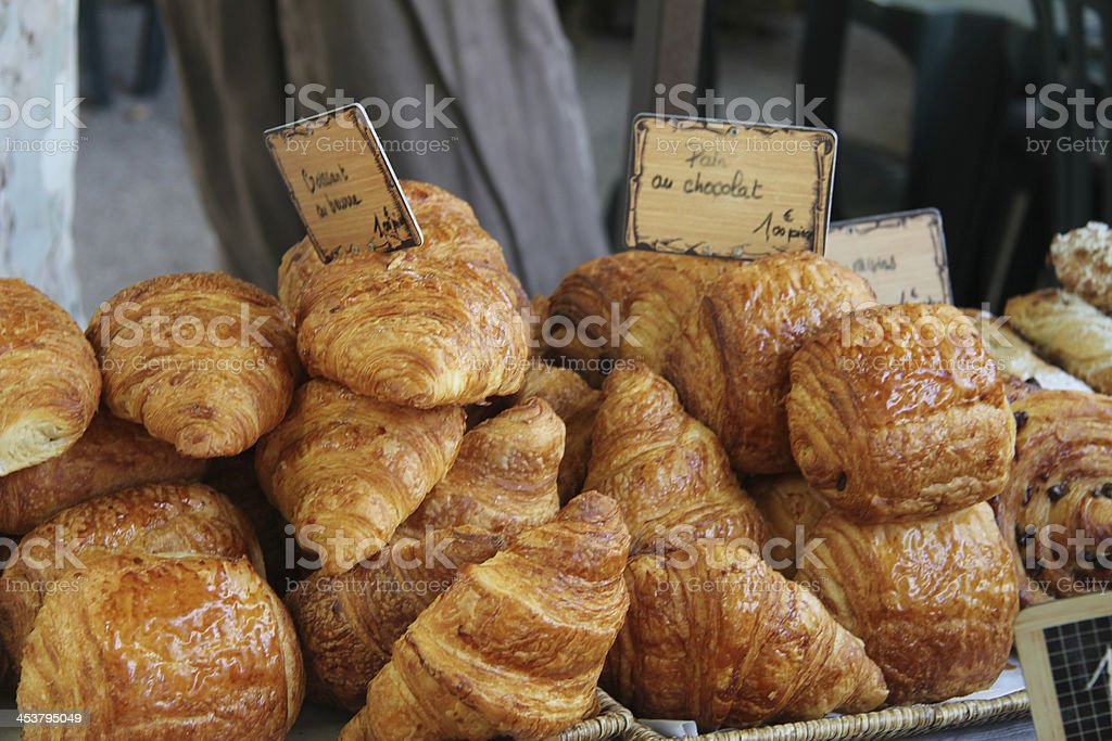 Fresh croissants and chocolate breads stock photo