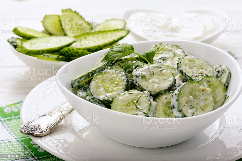 Fresh cucumber salad with yogurt and herbs. stock photo