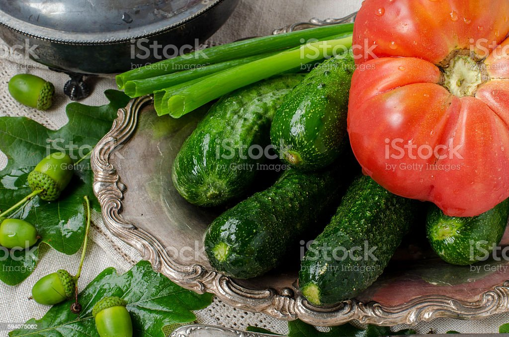 Fresh cucumbers and tomatoes in drops of water. stock photo