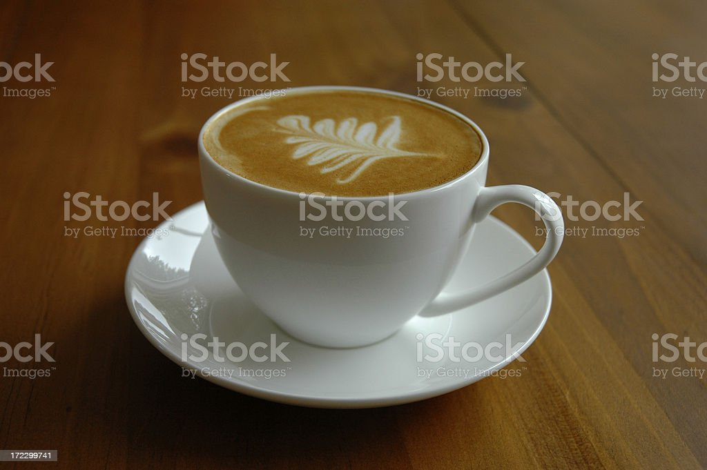 Fresh cup of coffee on wood royalty-free stock photo