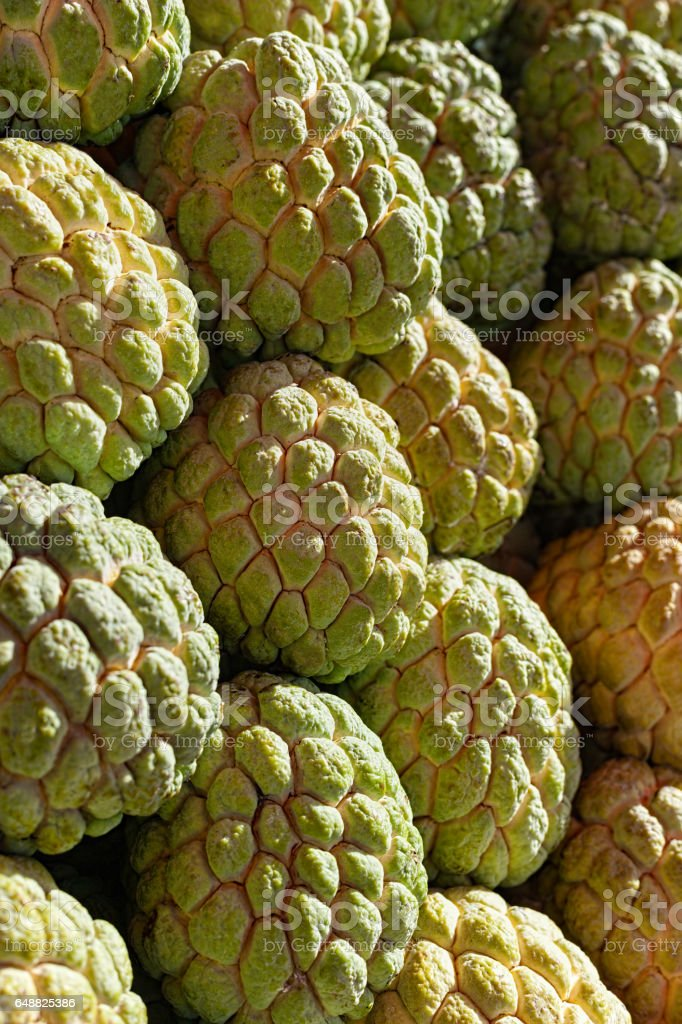 Fresh Custard Apple (Sugar-Apple or Pawpaw) fruit on display at a Thai market in Thailand. stock photo