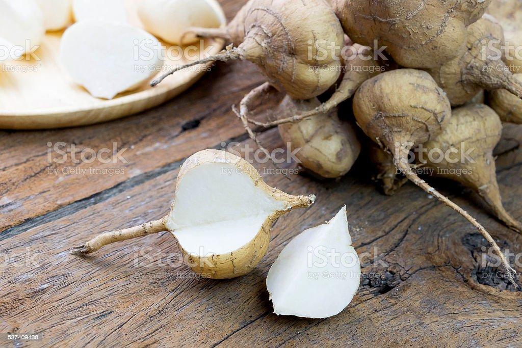 fresh cut asian jicama on wooden board stock photo