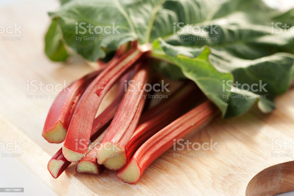 Fresh cut rhubarb laying on a table stock photo