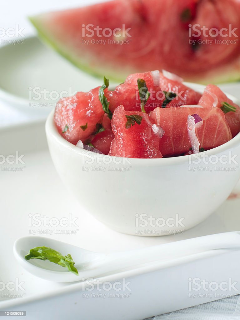 Fresh cut watermelon in a white bowl royalty-free stock photo