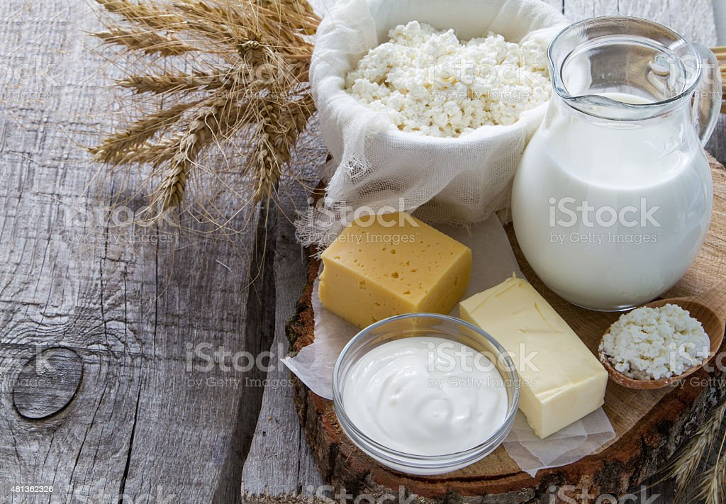 Fresh dairy products (milk, cottage cheese, cheese, butter, sour cream) stock photo