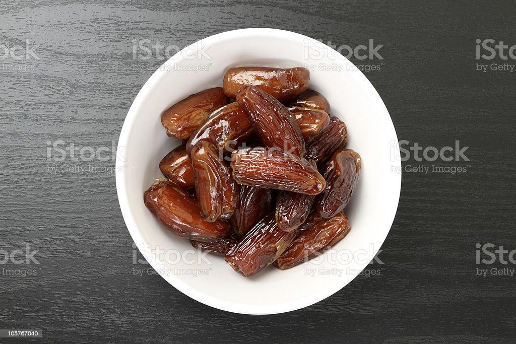 Fresh dates in a white bowl stock photo