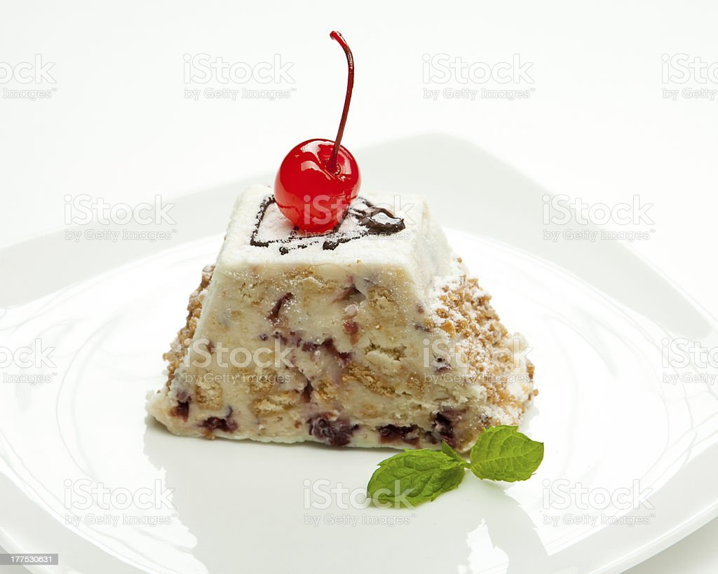 Fresh delicious cake with cherry on a white plate royalty-free stock photo