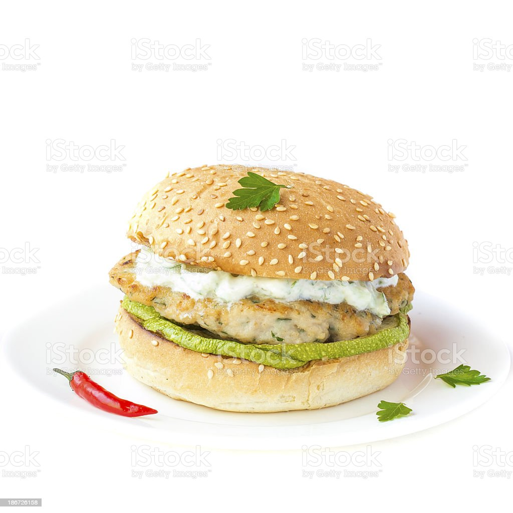 Fresh, delicious chicken burger in the Greek style with zucchini stock photo