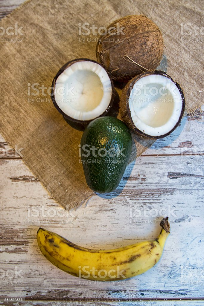 fresh, delicious coconut with avocado on a wooden background, tasty stock photo