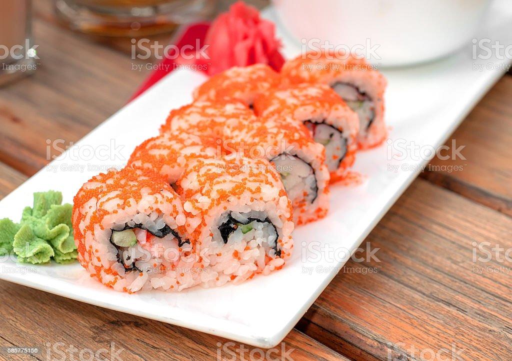 Fresh delicious maki and nigiri sushi sake glass stock photo