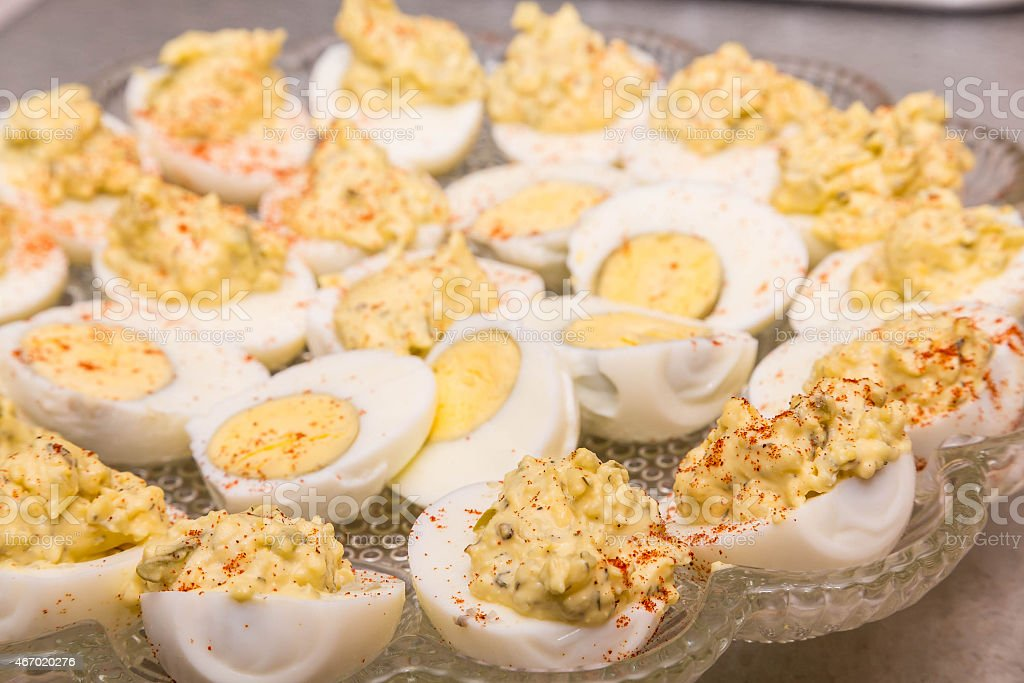 Fresh Devilled Eggs Garnished with Paprika stock photo