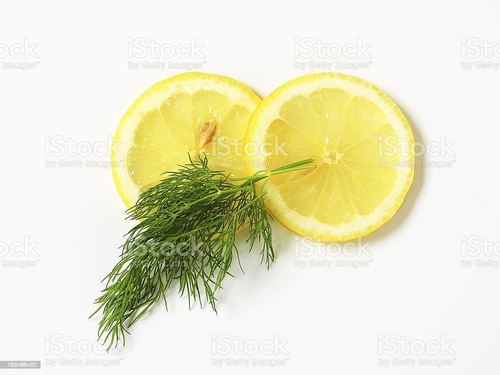 Fresh dill and lemon stock photo