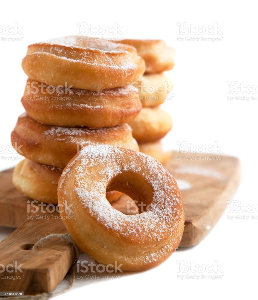 Fresh donuts with powder sugar isolated on white background. stock photo