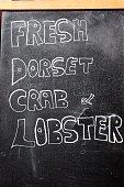 Fresh Dorset crab and lobster chalkboard sign.