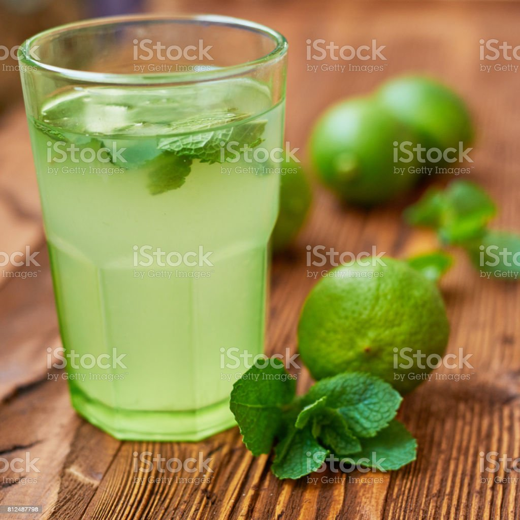 Fresh drink photo of home made limonade on wooden background stock photo