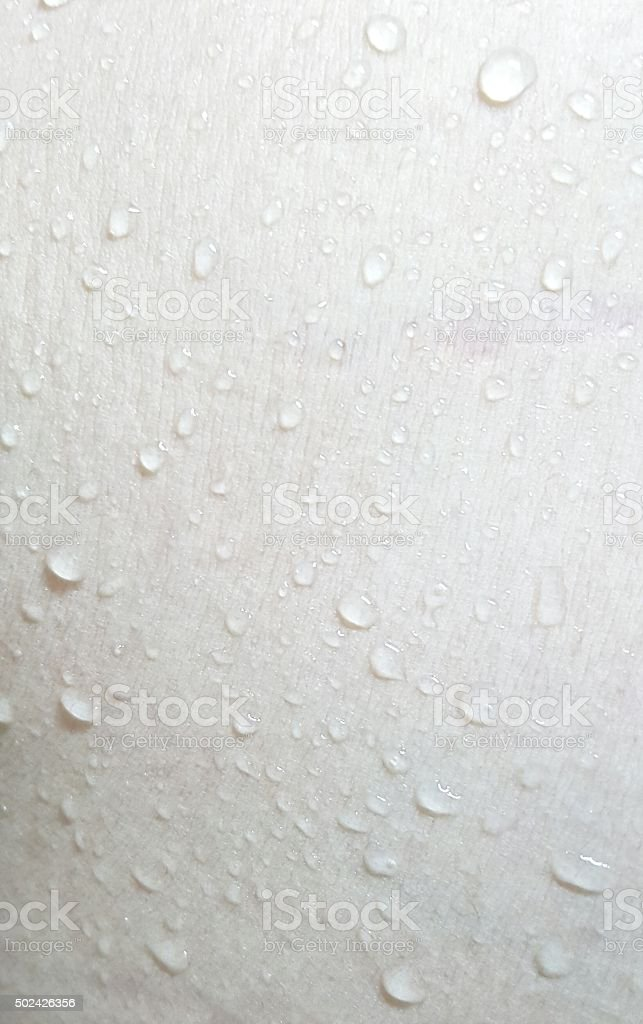 Fresh drop on part of skin body background stock photo