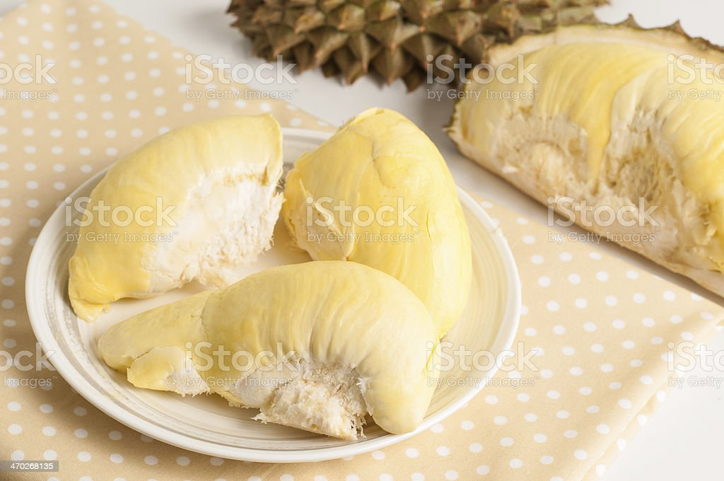 Fresh durian fruit on white plate. royalty-free stock photo