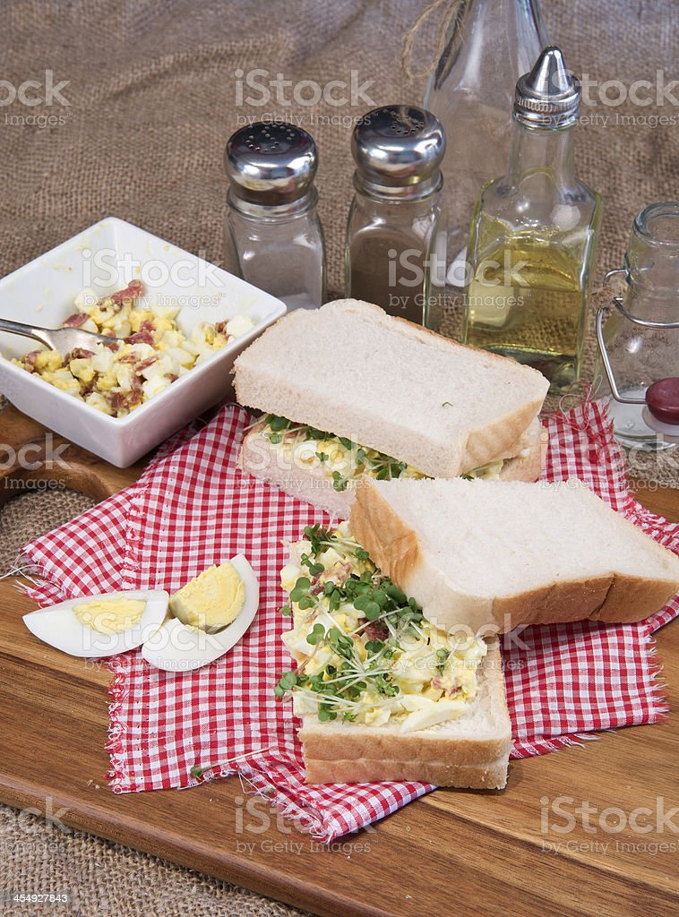 Fresh egg and bacon sandwich in rustic kitchen setting royalty-free stock photo