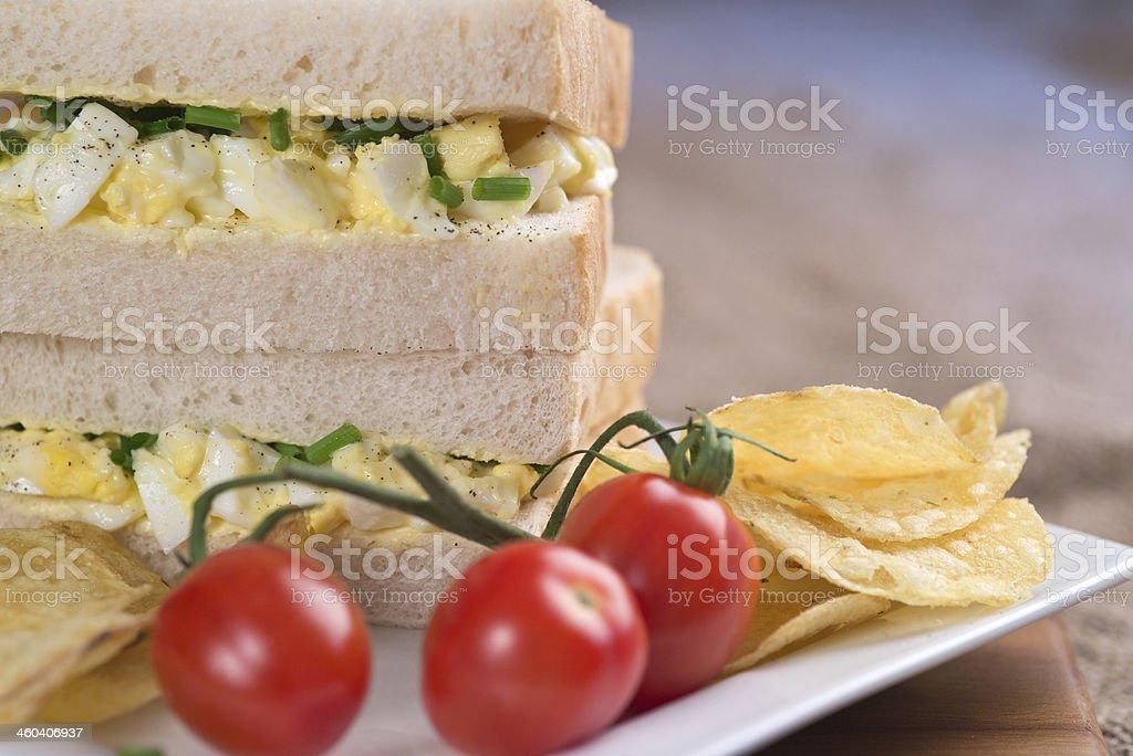 Fresh egg on white sandwich in kitchen setting royalty-free stock photo