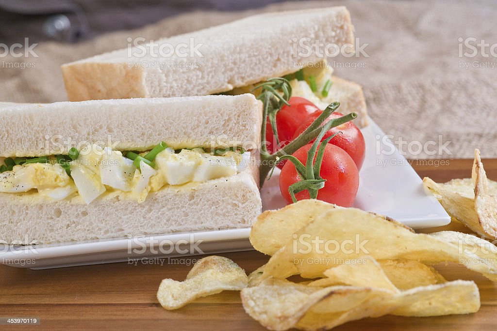 Fresh egg on white sandwich in rustic kitchen setting royalty-free stock photo
