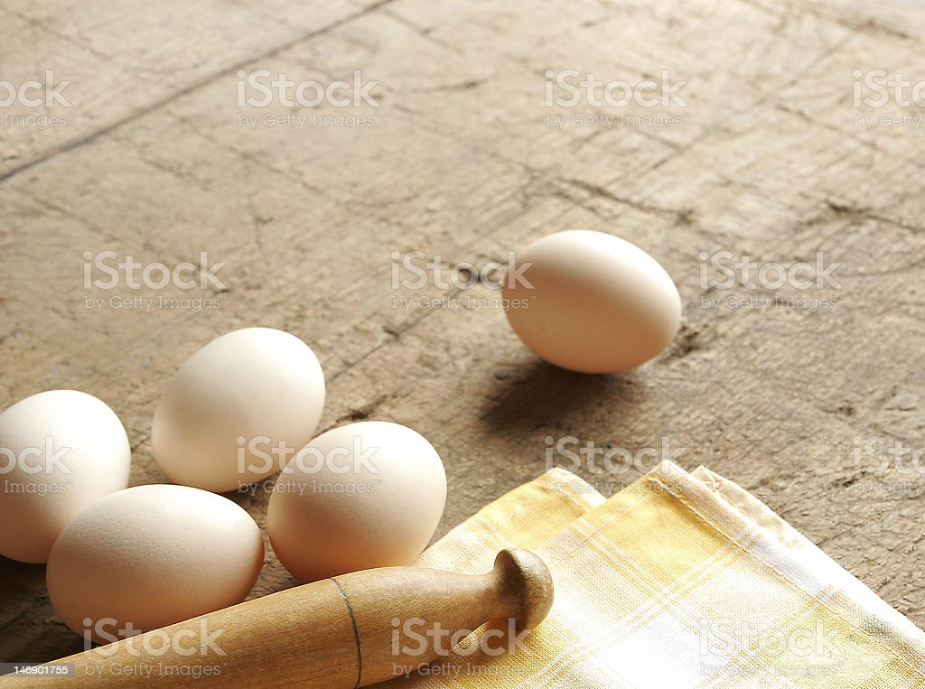 Fresh eggs and rolling pin royalty-free stock photo