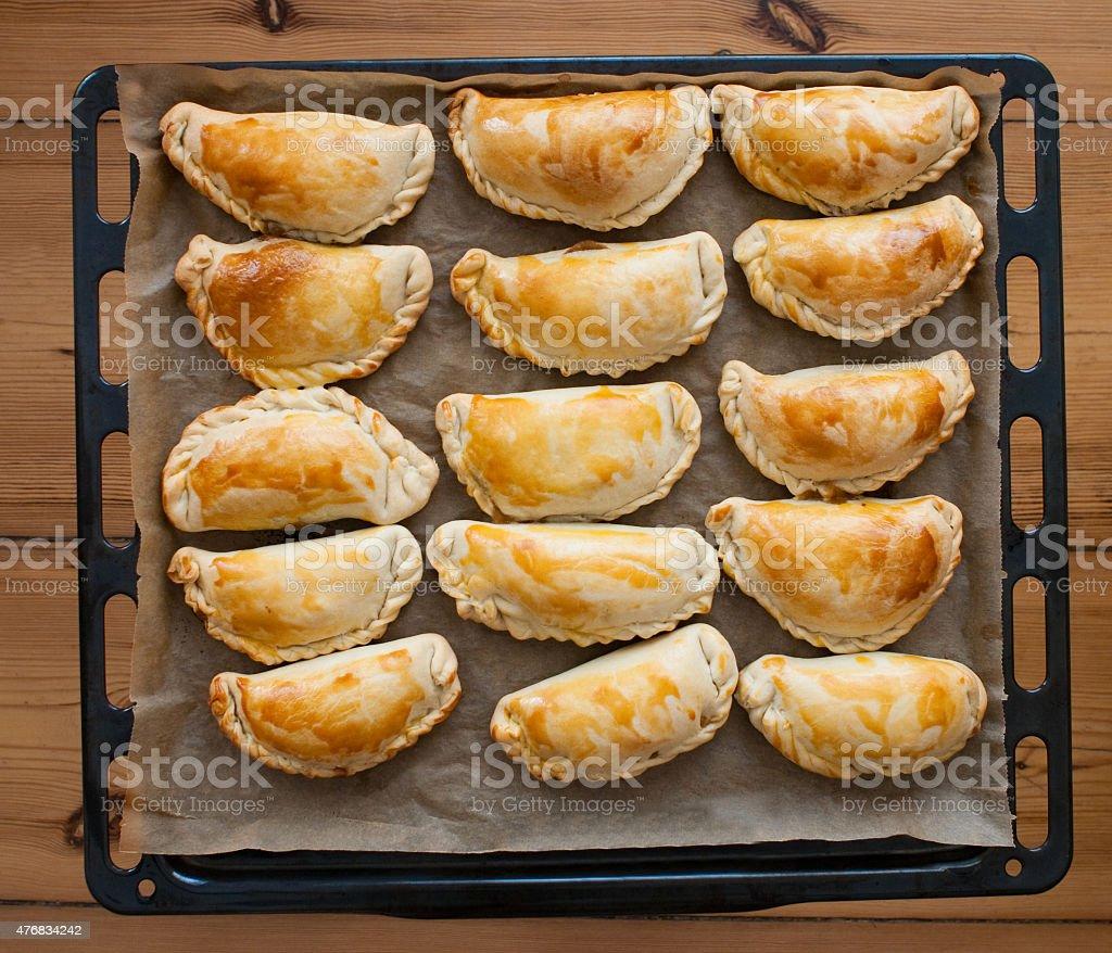 fresh empanadas - traditional food  on baking tray stock photo