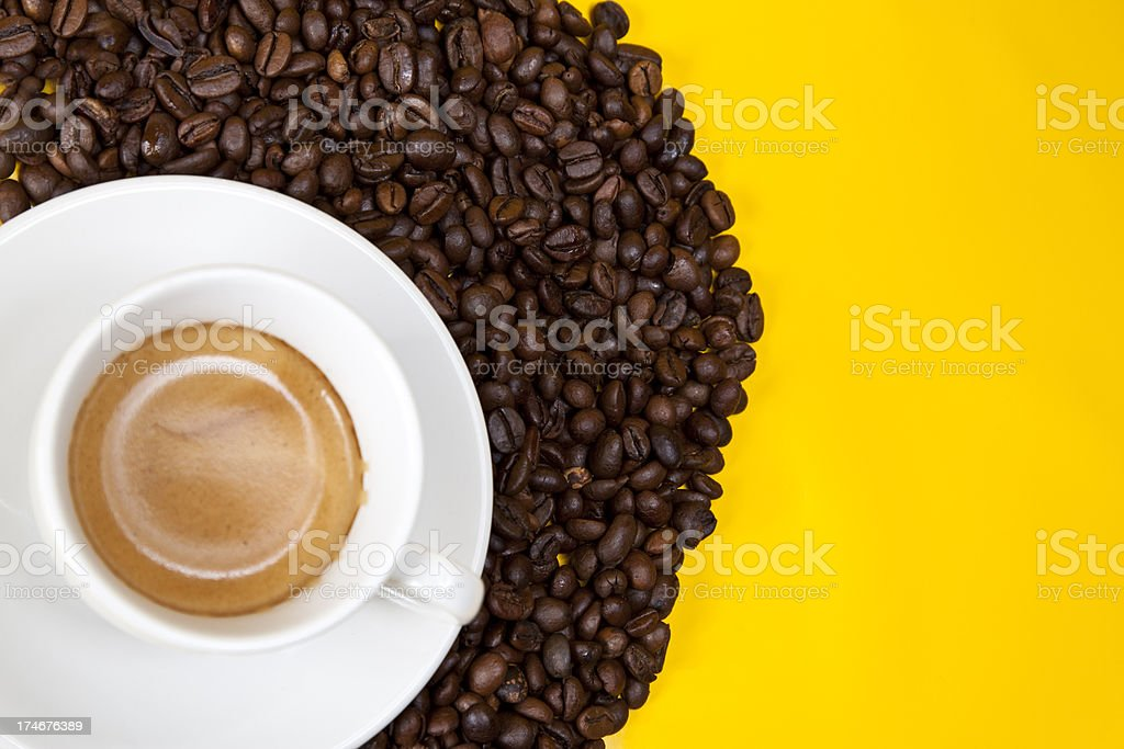fresh espresso and beans on yellow royalty-free stock photo