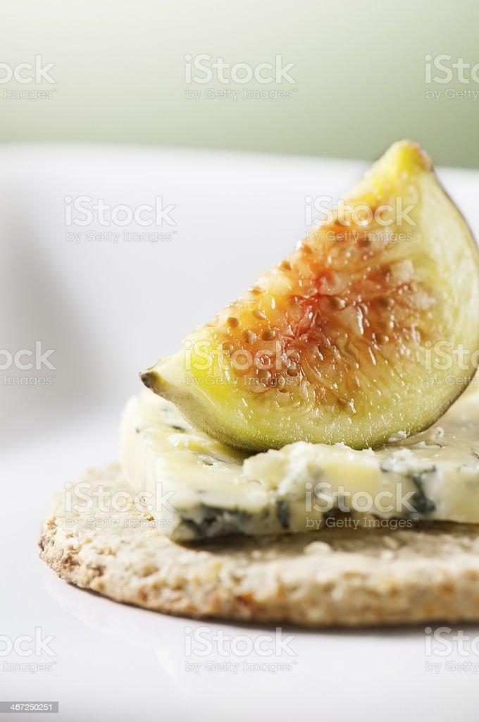 Fresh fig, stilton and oatcake on white ceramic plate stock photo