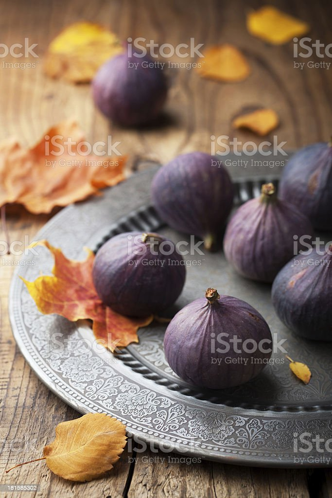 fresh figs and autumn leaves royalty-free stock photo